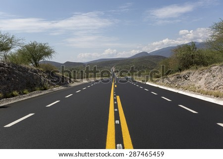 new road rolling through the Mexican mountains  - stock photo