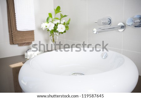 New round sink with stainless steel faucet - stock photo