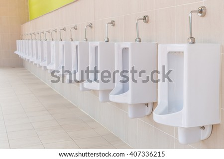 New row of outdoor urinals men public toilet - stock photo