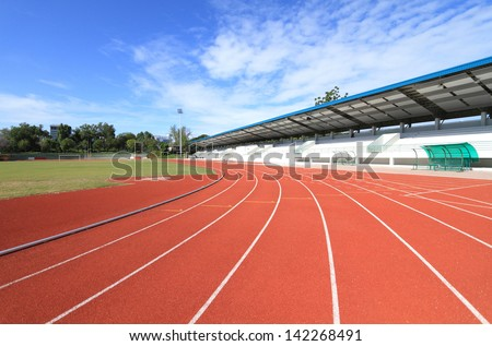 New running track and grandstand. - stock photo