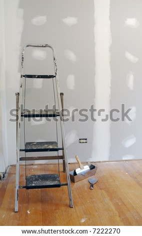 New sheetrock and ladder for home improvement. - stock photo