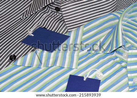New shirts for men with labels. Fashion concept - stock photo
