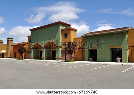 New Shopping Center with Blue Sky and Clouds - stock photo