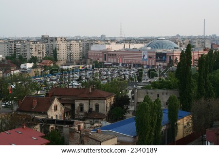 New shopping mall and old houses in Bucharest, Romania