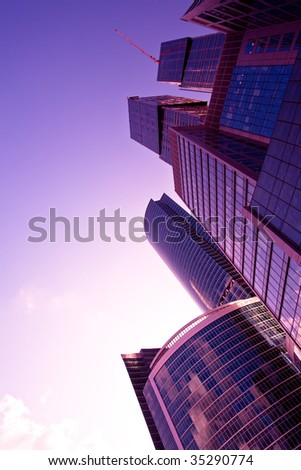 New skyscrapers at evening light,  violet sunshine - stock photo