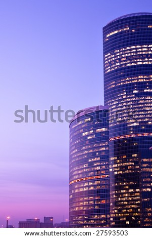 New skyscrapers at evening,  violet sunshine - stock photo