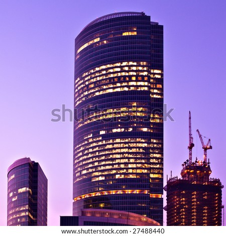 New skyscrapers business centre at night, square composition - stock photo