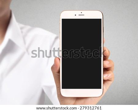 New smartphone in hand - stock photo
