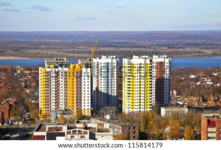 New Social apartment buildings in the residential area of Samara. Construction in the area of ??private houses on the banks of the Volga river. - stock photo