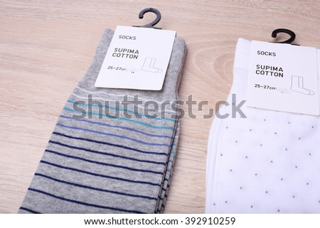 New socks on wooden background - stock photo
