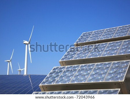 New solar panel and wind turbie - stock photo