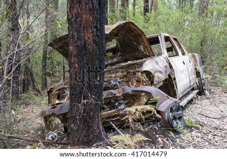 New South Wales, Australia  - March 20, 2016: Burnt out car in the forest