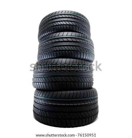 new sport summer tires stacked, over white, studio shot - stock photo