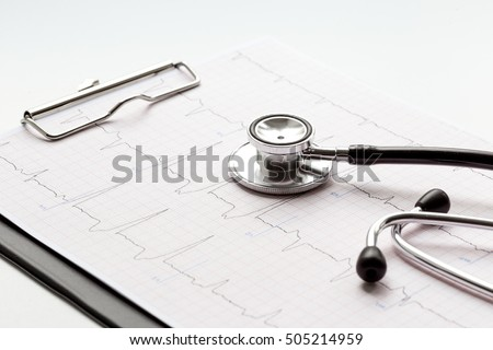 new stethoscope on a white background with cardiogram