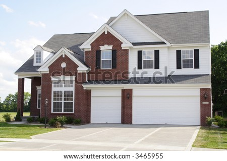 New 2 story brick home with 3 car garage - stock photo