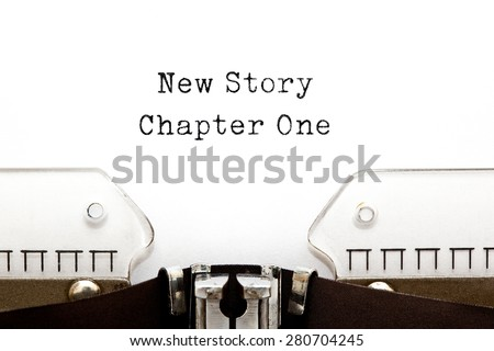 New Story Chapter One printed on a vintage typewriter. - stock photo