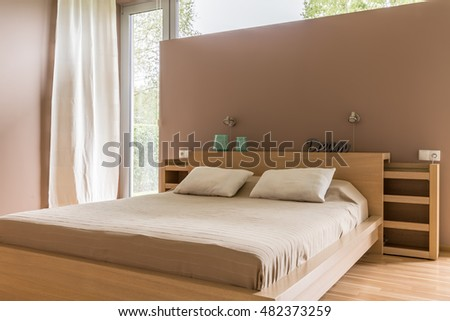 New style bedroom with large bed and balcony
