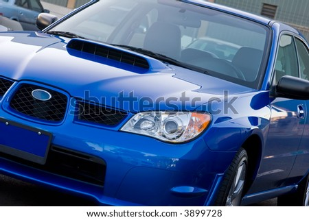 New Subaru sitting in a car lot waiting to be sold - stock photo