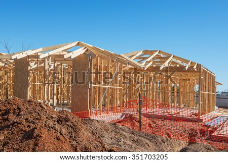 new suburban homes currently under construction  - stock photo