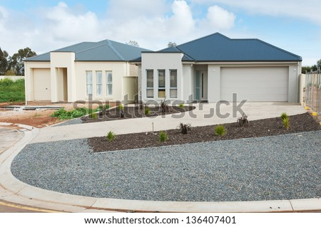 new suburban homes currently under construction against cloudy sky - stock photo