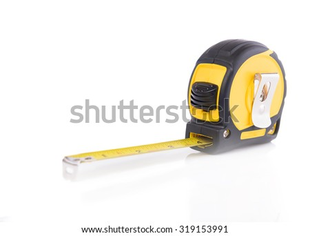 New tape measure isolated on white background - stock photo