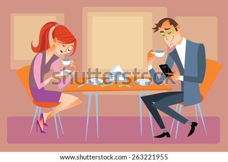 New technologies and family. Husband and wife are sitting at the dining table and not talk, but looking at their phones - stock photo