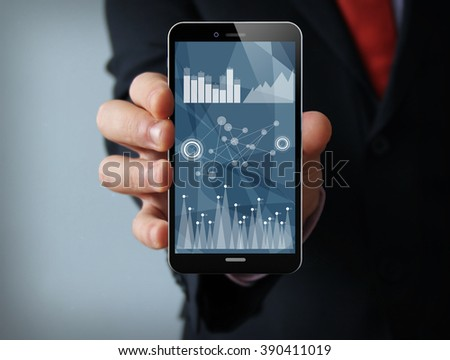 new technologies business concept: businessman hand holding a 3d generated touch phone with statistics on the screen. Screen graphics are made up.
