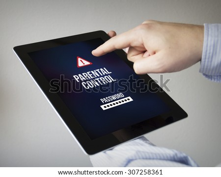 new technologies concept: hands with touchscreen tablet with parental control on the screen. Screen graphics are made up.