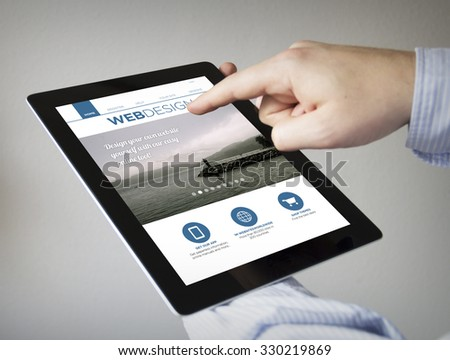 new technologies concept: hands with touchscreen tablet with webdesign website on the screen. Screen graphics are made up.  - stock photo