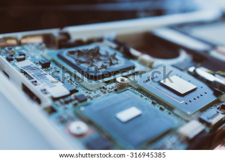 new technologies in the computer industry. Processor, motherboard and parts of the computer. Macro. Modern - stock photo