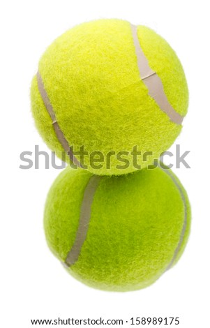 New tennis balls on the mirror.  Isolated on white background