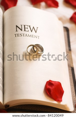 New Testament; New Testament And Wedding Rings - stock photo