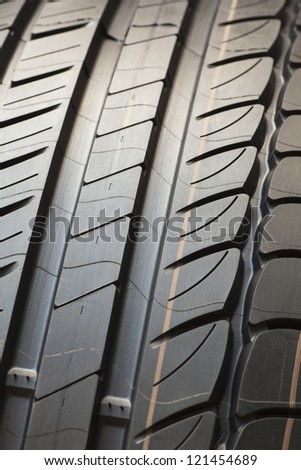 New tire. Detail of brand new tire isolated - stock photo