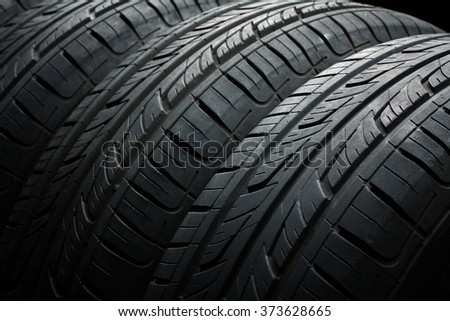 new tires,just bought,are close to each other. Photo a closeup - stock photo