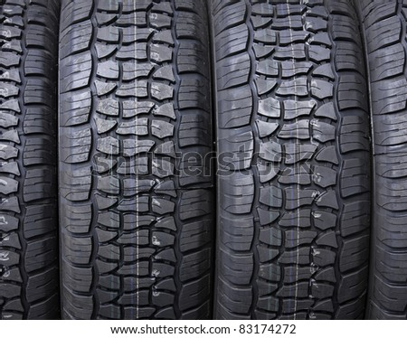 New tires on display at a tire store. - stock photo