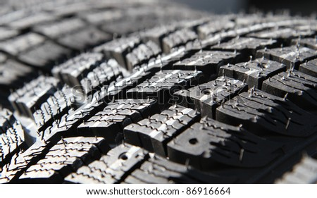 New tires stacked - stock photo