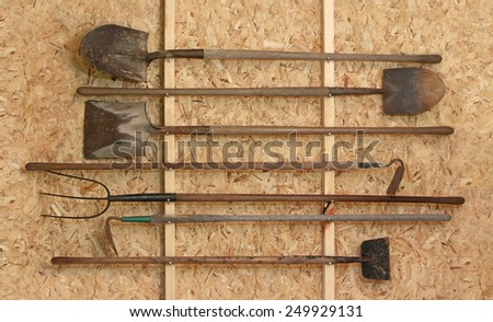 New tool shed with horizontally placed vintage tools - stock photo