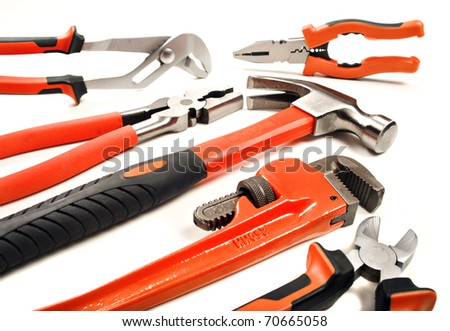New tools - hammer pliers and a wrench on a white background with space for text - stock photo