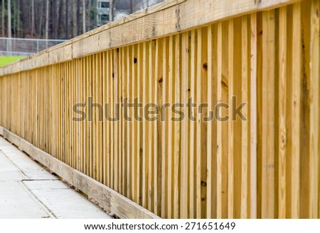 New treated pine lumber railings on the side of a bridge - stock photo