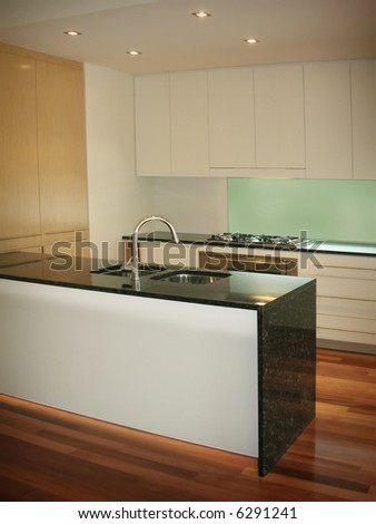 New trendy kitchen in luxury home - stock photo