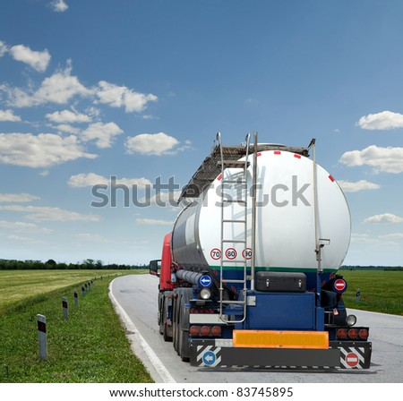 new truck with tank trailer driving the highway - stock photo
