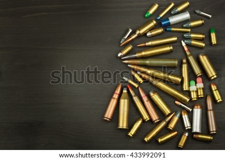 New types of ammunition. Bullets of different calibers and types. The right to own a gun. Sales of weapons and ammunition.  - stock photo