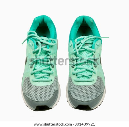 New unbranded running shoe, sneaker or trainer on white background - stock photo