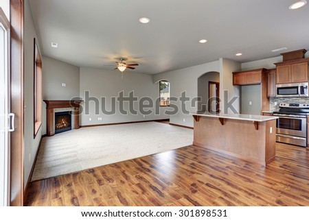 New unfurnished home interior, including dinning room, living room, and kitchen. - stock photo