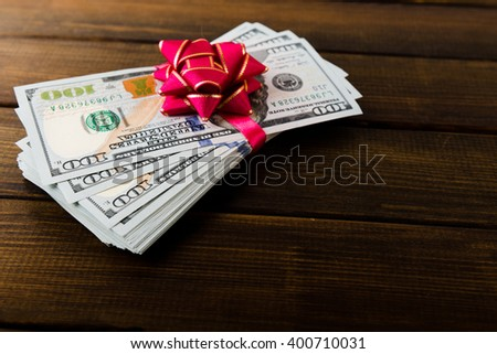 new 100 US dollars 2013 edition banknotes (bills) on wooden background - stock photo