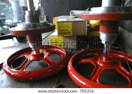 new valves on work bench - stock photo