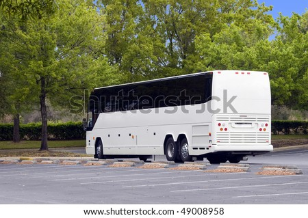 New white Bus with tinted windows waiting for decaling and purchase - stock photo