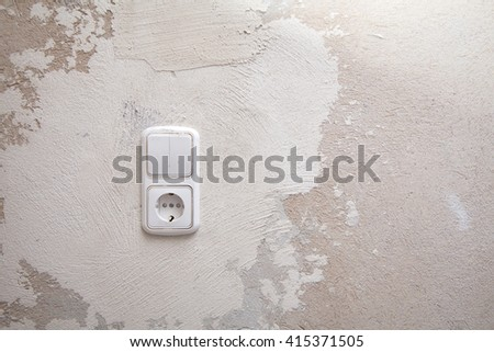 New white socket in the wall to repair the apartment