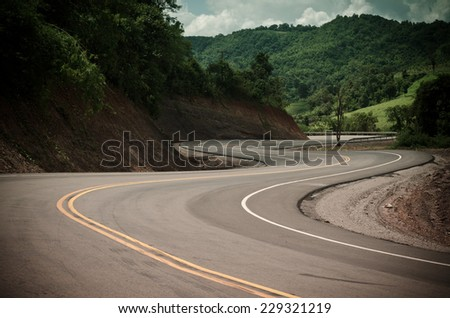 New winding road in the mountain - stock photo