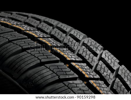 New winter tire closeup - stock photo